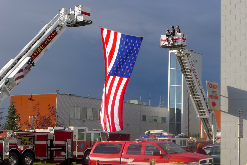Firefighters and flag